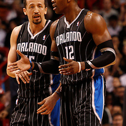 March 3, 2011; Miami, FL, USA; Orlando Magic center Dwight Howard (12) and small forward Hedo Turkoglu (15) talk during the second quarter against the Miami Heat at the American Airlines Arena.    Mandatory Credit: Derick E. Hingle