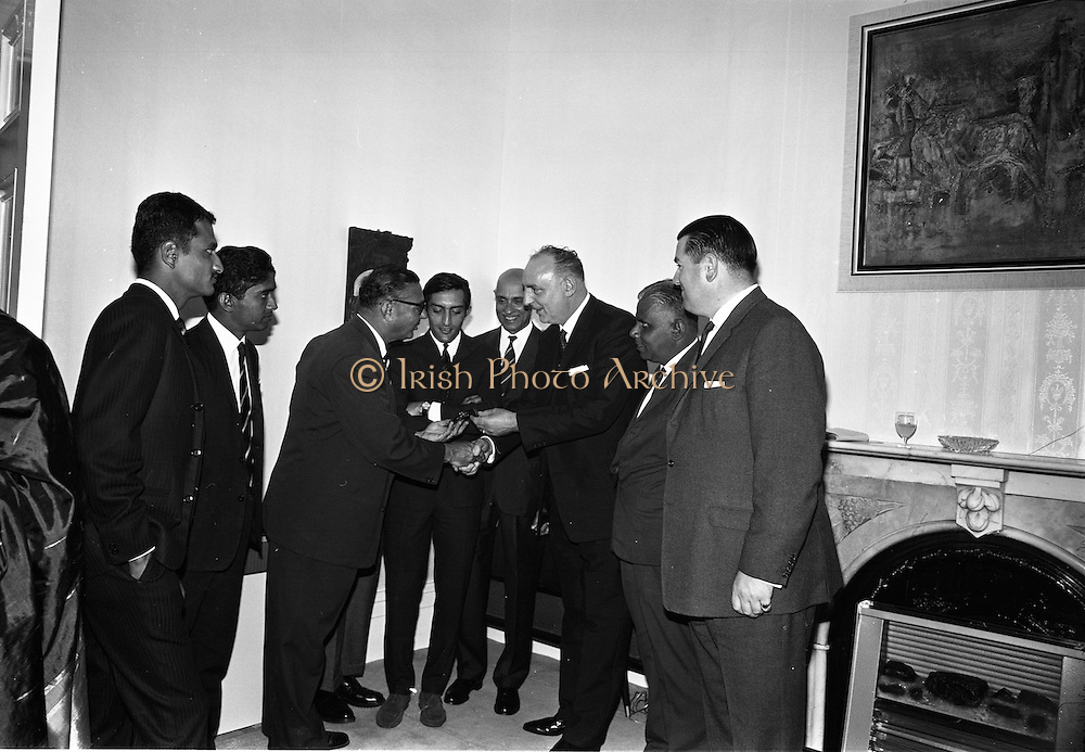 22/07/1967<br /> 07/22/1967<br /> 22 July 1967<br /> Reception at the Indian Embassy for Cricket team. The Indian team was on a tour of the British Isles and had played and beaten the Irish team the day before. Thomas Stafford, Lord Mayor of Dublin on right making a presentation.