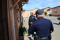 Salinas police officer Jeffrey Lofton, shown, and partner Richard Lopez go door-to-door along Fremont Street to introduce residents to the CASP program. The Community Alliance for Safety and Peace is an ambitious program that aims to steer youth away from gang violence and toward solutions offered by more than 30 local organizations offering alternatives.
