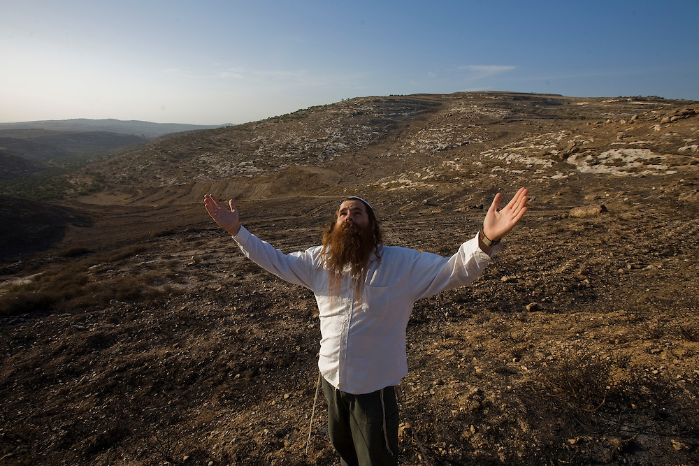 "The Rabbi Lupo pray during ""isolation prayer"" in the Havat Gilad Settlement."