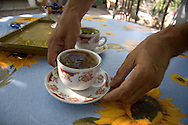 Tofik Akhmedov serves a cup of tea at his home in the Chalabixan camp for internally displaced people from Nagorno-Karabakh, near Sheki, Azerbaijan.