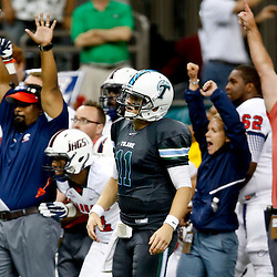 Sep 7, 2013; New Orleans, LA, USA; Tulane Green Wave quarterback Nick Montana (11) reacts after failing to convert a two point conversion that would have tied the game during the fourth quarter of a game against the South Alabama Jaguars at the Mercedes-Benz Superdome. South Alabama defeated Tulane 41-39. Mandatory Credit: Derick E. Hingle-USA TODAY Sports