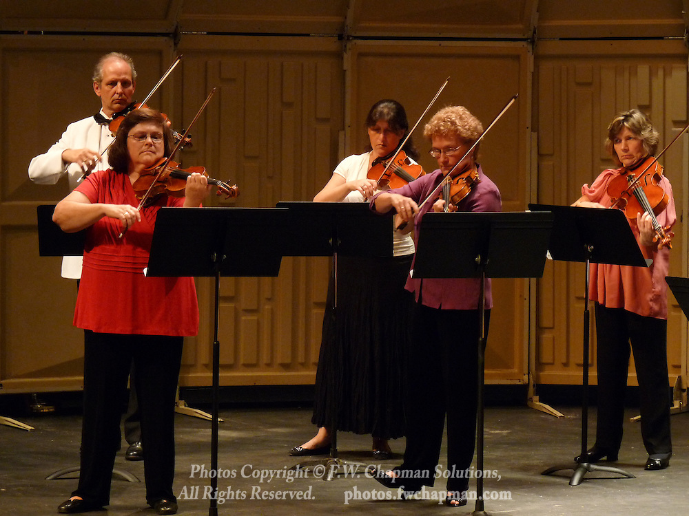 Valley Vivaldi string players Simon Maurer, Mary Ogletree, Inna Eyzerovich, Rebecca Brown, violins, and Agnès Maurer, viola, perform in a Sunday evening concert starting at 7:30 PM on June 28, 2009 at Cedar Crest College in Allentown, Pennsylvania, USA.