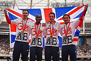 Great Britain's 4 x 400m Relay team (L-R) Martyn Rooney, Michael Bingham, Andrew Steele, Robert Tobin are presented with their Bronze medals from the Beijing Olympics 2008 during the Muller Anniversary Games at the London Stadium, London, England on 9 July 2017. Photo by Martin Cole.