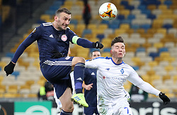 February 21, 2019 - Kiev, Ukraine - Olympiakos' Vasilis Torosidis, left, and Dynamo Kiev's Benjamin Verbic, right, in the fight for the ball during the second leg of the Europa League football match of the 32nd stage between Dynamo Kiev and Olympiacos at the Olympic Stadium in Kiev. Ukraine, Thursday, February 21, 2019  (Credit Image: © Danil Shamkin/NurPhoto via ZUMA Press)