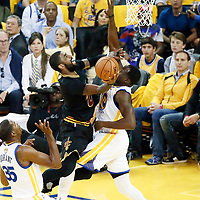 12 June 2017: Cleveland Cavaliers guard Kyrie Irving (2) goes for the layup against Golden State Warriors forward Draymond Green (23) during the Golden State Warriors 129-120 victory over the Cleveland Cavaliers, in game 5 of the 2017 NBA Finals, at the Oracle Arena, Oakland, California, USA.