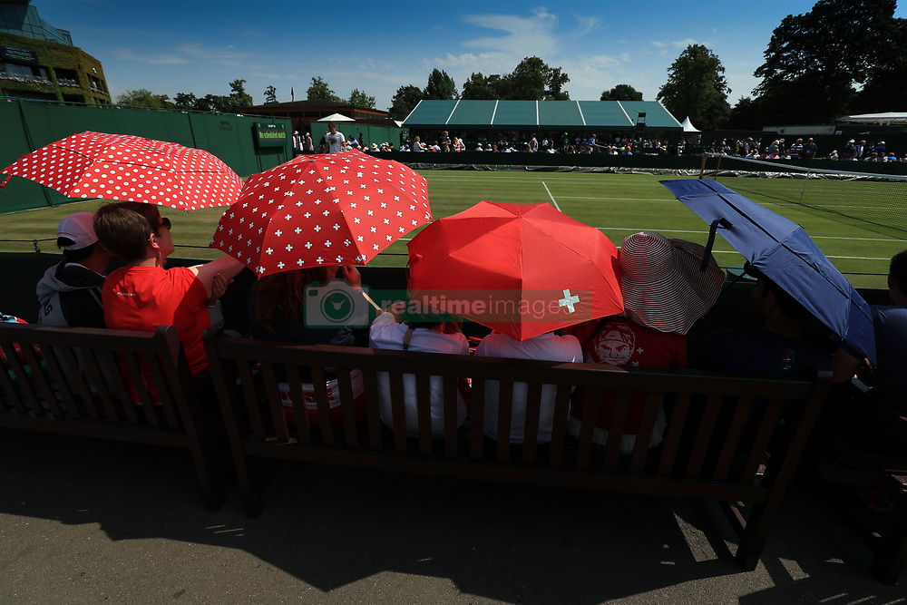 6 July 2017 -  Wimbledon Tennis (Day 4) - Fans of Roger Federer wait for play to start on the outside courts - Photo: Marc Atkins / Offside.