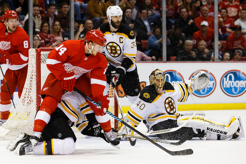 Apr 2, 2015; Detroit, MI, USA; Detroit Red Wings center Gustav Nyquist (14) fight for position with with Boston Bruins defenseman Dennis Seidenberg (44) in front of goalie Tuukka Rask (40) in the first period at Joe Louis Arena. Mandatory Credit: Rick Osentoski-USA TODAY Sports