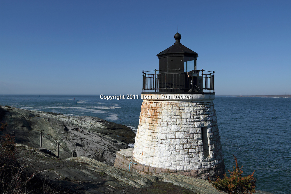 Castle Hill Lighthouse on a clear day, Newport, Rhode Island, USA. The Castle Hill Lighthouse sits on the eastern shore marking the entrance to Narragansett Bay.