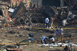 August 8, 2017 - Lahore, Punjab, Pakistan - Pakistani security officials investigate the site following an overnight bomb explosion placed inside a truck in Lahore on August 8, 2017. A truck bomb injured at least 34 people and 2 dead late on August 7 in Pakistan, officials said, in the latest bombing to rattle the eastern city of Lahore. 'The explosive material was planted inside a truck which was loaded with fruit. (Credit Image: © Rana Sajid Hussain/Pacific Press via ZUMA Wire)