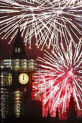 © Licensed to London News Pictures. 01/01/2018. London, UK. Fireworks on the Thames by Parliament and Big Ben, covered in scaffolding,  herald the start of the New Year in 2018. Photo credit: Peter Macdiarmid/LNP