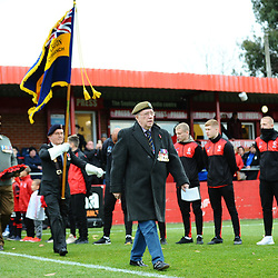 TELFORD COPYRIGHT MIKE SHERIDAN 3/11/2018 - Members of the Alfreton branch of the Royal British Legion lead the teams out during a remembrance ceremony prior to the Vanarama Conference North fixture between Alfreton Town vs AFC Telford United.