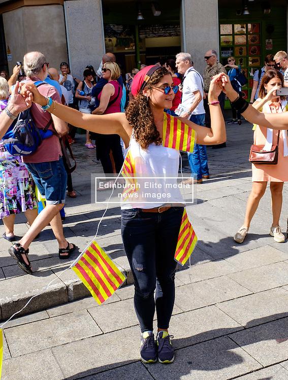 A Catalan girl dancing the Sardana, a traditional dance  in the Palau de la Generalitat de Catalunya near Barcelona Cathedral<br /> <br /> (c) Andrew Wilson   Edinburgh Elite media