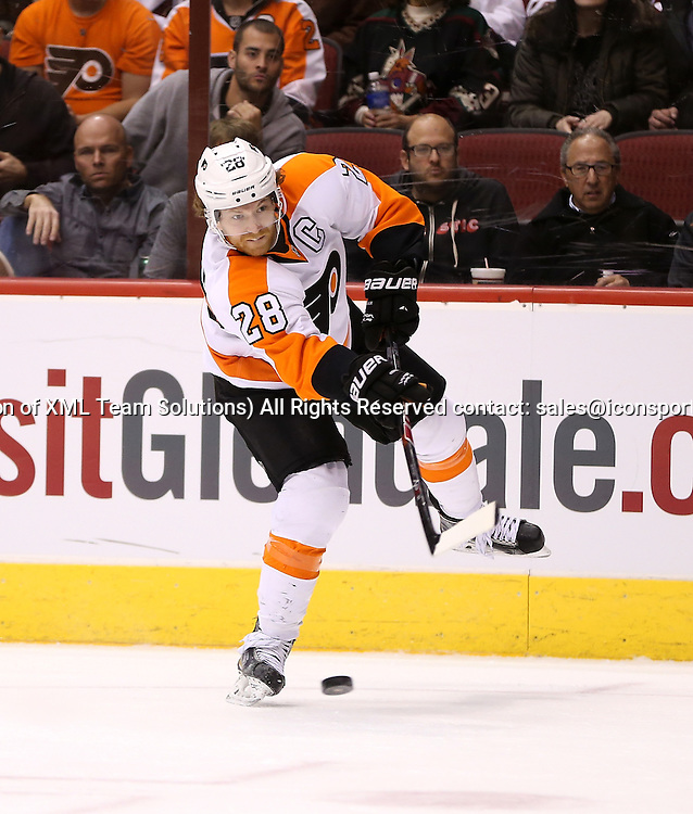 29 December 2014: Philadelphia Flyers center Claude Giroux #28 shoots the puck during the third period of the NHL regular season game between the Philadelphia Flyers and the Arizona Coyotes at Gila River Arena in Glendale, Az. The Arizona Coyotes beat the Philadelphia Flyers 4-2.