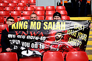 Liverpool  fans hope to get Liverpool forward Mohamed Salah (11) attention and his shirt with their banner during the Premier League match between Liverpool and Tottenham Hotspur at Anfield, Liverpool, England on 31 March 2019.
