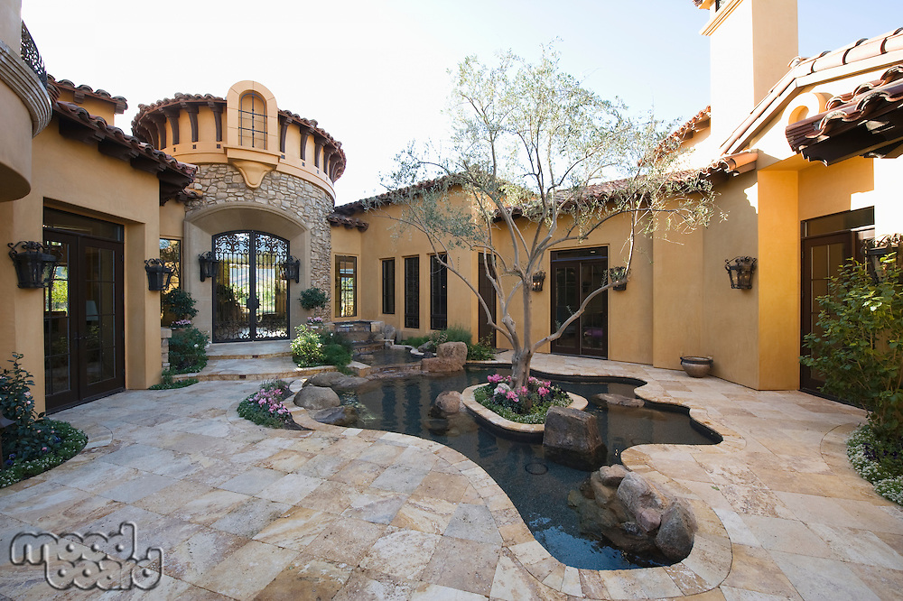 Paved courtyard garden with pool Palm Springs