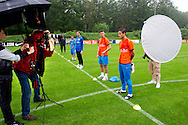 NETHERLANDS, HOENDERLOO : A photographer is taking a head shot of Ibrahim Afellay before the training at the trainingcamp of the Netherlands national football team in Hoenderloo on May 31, 2012. AFP PHOTO/ ROBIN UTRECHT