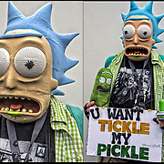 &quot;Prefect Josh Cosplayer Extraordinaire&quot; in his  costume and sign &quot;Tickle my pickle&quot; from the animated television series Rick and Morty on Cartoon Network's late night programming.<br /> <br /> <br /> Cosplay, a contraction of the words costume play, is a performance art in which participants called cosplayers wear costumes and fashion accessories to represent a specific character.<br /> <br /> Cosplayers often interact to create a subculture and a broader use of the term &quot;cosplay&quot; applies to any costumed role-playing in venues apart from the stage. Any entity that lends itself to dramatic interpretation may be taken up as a subject and it is not unusual to see genders switched. Favorite sources include manga and anime, comic books and cartoons, video games, and live-action films and television series.<br /> <br /> The New York Comic Con convention, is a celebration of comic books, graphic novels, sci-fi and video games, toys, movies and television. The convention brings together celebrities as well as fans of fantasy role playing, Comic-Con is the business of pop culture.