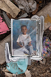 10 December, 05. New Orleans, Louisiana. Post Katrina aftermath.<br />  A broken photo frame lies in the front porch of a house in Gentilly where sadly a victim of the storm perished.<br /> Photo; ©Charlie Varley/varleypix.com