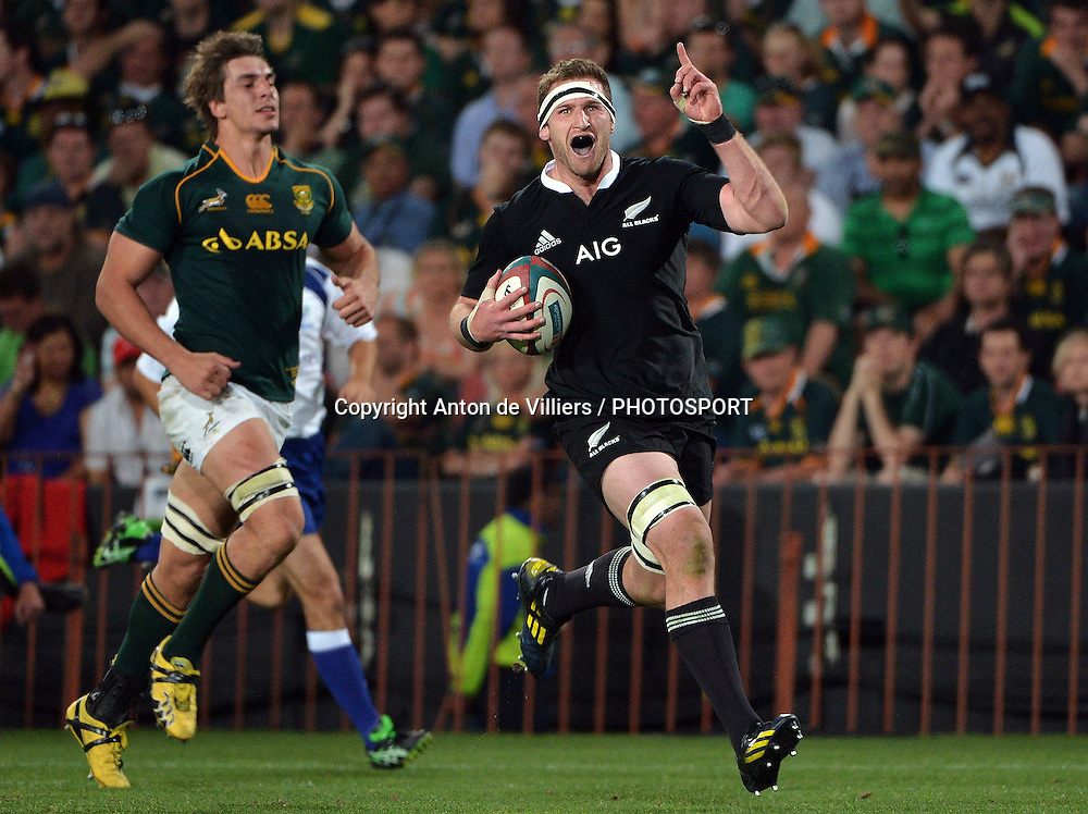 JOHANNESBURG, South Africa, 05 October 2013 : Kieran Read of the All Blacks celebrates the victory with his try during the Castle Lager Rugby Championship test match between SOUTH AFRICA and NEW ZEALAND at ELLIS PARK  in Johannesburg, South Africa on 05 October 2013. The All Blacks won the trophy by beating the Boks 38-27.<br /> <br /> &copy; Anton de Villiers / PHOTOSPORT