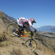 Darryn Henderson from Christchurch in action during the New Zealand South Island Downhill Cup Mountain Bike series held on The Remarkables face with a stunning backdrop of the Wakatipu Basin. 150 riders took part in the two day event. Queenstown, Otago, New Zealand. 9th January 2012. Photo Tim Clayton