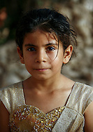 Yemen, portrait of an Yemeni girl with heart shaped dress. According to the United Nations, approximately one-third of the women in Yemen marry before the age of 18. Some girls as young as 10 years old are forced into arranged marriages. Many activists campaign to end this practice, but in the more remote areas, it is a difficult task. Furthermore, Yemen is a country where female genital mutilation (FGM) remains widespread, despite being banned by the Ministry of Public Health.