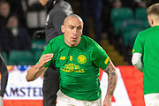 Celtic Captain Scott Brown (C) (#8) completes his warm up ahead of the Europa League match between Celtic and Rennes at Celtic Park, Glasgow, Scotland on 28 November 2019.