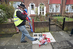 © Licensed to London News Pictures. 11/04/2018. London, UK. A man who gave his name as Iain Gordon kicks some bouquets along the pavement after removing all the floral tributes from near the house of Richard Osborn-Brooks. Henry Vincent was killed as he burgled the home of 78 year old Richard Osborn-Brooks. Mr Osborn-Brooks was arrested for murder but later released without charge. Friends and family of Henry Vincent have had floral tributes they placed near the scene repeatedly torn down by locals. Photo credit: Peter Macdiarmid/LNP