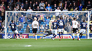 Lee Gregory completes his hat trick from the spot during the Sky Bet Championship match between Millwall and Derby County at The Den, London, England on 25 April 2015. Photo by David Charbit.