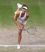 30/06/2011 - Wimbledon (Day 10) - Ladies' Singles Semi-Finals - Maria Sharapova vs. Sabine Lisicki - Maria Sharapova serves - Photo: Simon Stacpoole / Offside.