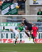 27th August 2017, Dens Park, Dundee, Dundee; Scottish Premier League football, Dundee versus Hibernian; Dundee's Kerr Waddell heads clear from Hibernian's Vykintas Slivka