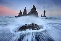 Basalt sea stacks rise from stormy seas, Reynisdrangar, Iceland.