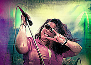 "Oct. 22, 2011 - Merrick, New York, U.S. - Blues singer Sweet Suzi Smith making ""Rock On'sign during Sweet Suzi & Sugafixx performance at Merrick Street Fair."