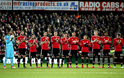 Manchester United players stand for a minute's applause for Jimmy Armfield, who died this week, before the Emirates FA Cup, fourth round match at Huish Park, Yeovil.