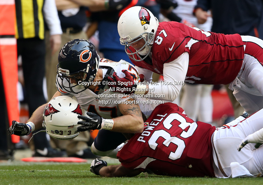 Dec. 23, 2012 - Phoenix, AZ, USA - Chicago Bears' Chris Conte tackles Arizona Cardinals' William Powell in 2nd quarter at University of Phoenix Stadium on Sunday, December 23, 2012, in Phoenix, Arizona. The Chicago Bears defeated the Arizona Cardinals, 28-13.