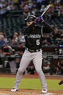 PHOENIX, AZ - SEPTEMBER 14:  Carlos Gonzalez #5 of the Colorado Rockies stands at bat against the Arizona Diamondbacks in the first inning at Chase Field on September 14, 2017 in Phoenix, Arizona.  (Photo by Jennifer Stewart/Getty Images)