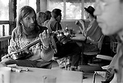 Hank playing the banjo in Goose hall at Glastonbury, 1989.