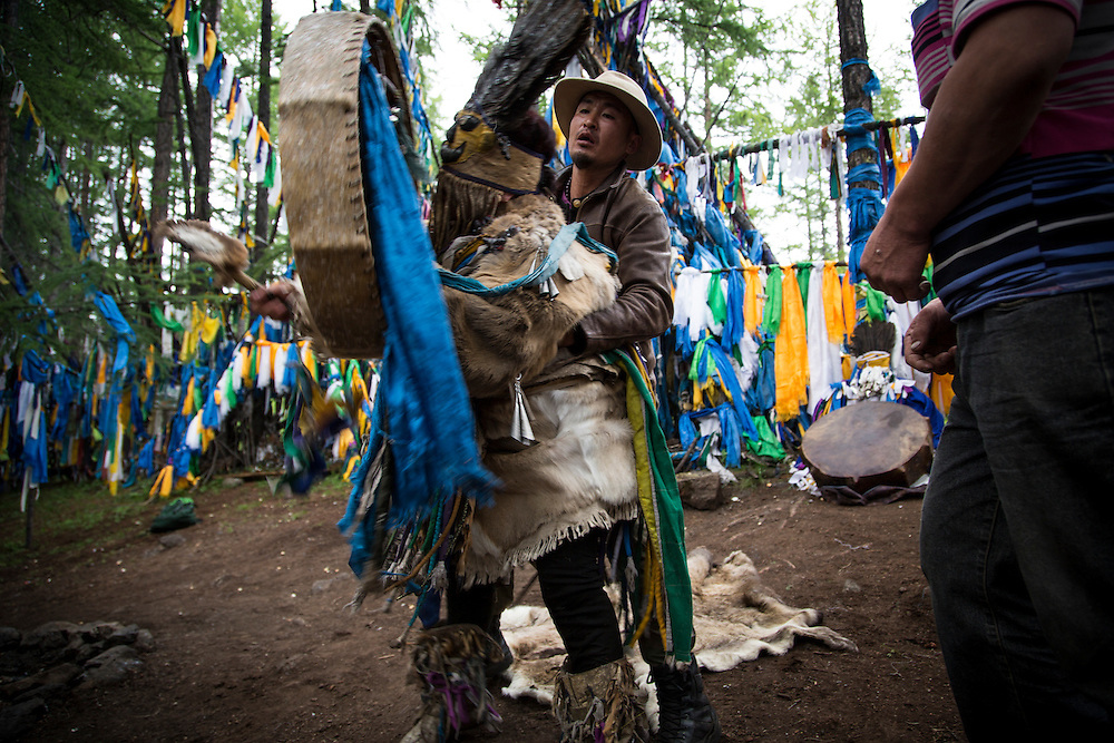 A traditional Shaman preforms a ceremony to communicate with the spirits of wind and water at Lake Hovsgol on July 27, 2012, © 2012 Tom Turner Photography