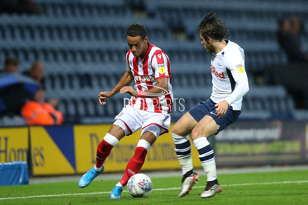 Stoke City midfielder Thomas Ince (7) and Preston North End midfielder Ben Pearson (4) during the EFL Sky Bet Championship match between Preston North End and Stoke City at Deepdale, Preston, England on 21 August 2019.