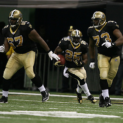 2007 October, 21: New Orleans Saints running back Reggie Bush (25) runs behind offensive linemen Jamar Nesbit (67) and Jahri Evans (73) during a 22-16 win by the New Orleans Saints over the Atlanta Falcons at the Louisiana Superdome in New Orleans, LA.