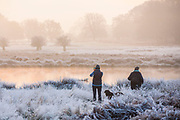 UNITED KINGDOM, London: 22 November 2018 Early morning walkers stop to take a picture during a frosty Richmond Park during sunrise this morning. Temperatures sunk to zero degrees in the capital last night. Rick Findler  / Story Picture Agency