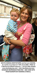 SANTA SEBAG-MONTEFIORE and her son SASHA, at a party in London on 10th June 2004.PWA 10