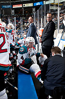 KELOWNA, CANADA - SEPTEMBER 29: Gordie Ballhorn #4 of the Kelowna Rockets gets a skate adjustment by equipment manger Chaydyn Johnson against the Everett Silvertips on September 29, 2017 at Prospera Place in Kelowna, British Columbia, Canada.  (Photo by Marissa Baecker/Shoot the Breeze)  *** Local Caption ***