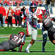 Mississippi's Randall Mackey (1) runs the ball past Arkansas linebacker A.J. Turner (31) and safety Rohan Gaines (26) during an NCAA college football game in Little Rock, Ark., Saturday, Oct. 27, 2012. (Photo/Thomas Graning)