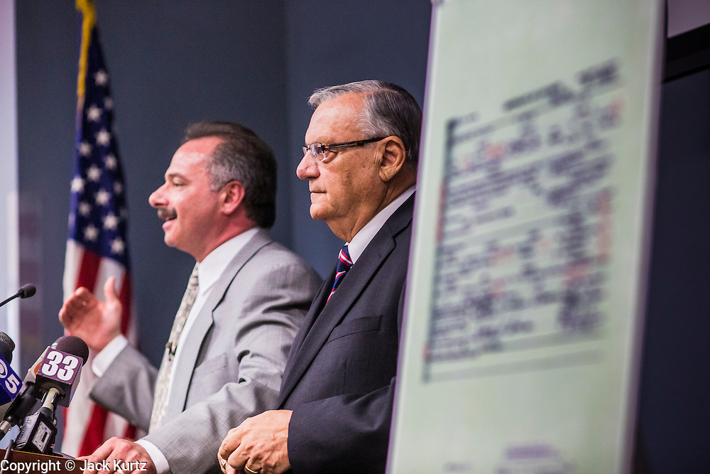 17 JULY 2012 - PHOENIX, AZ: MIKE ZULLO (left), the Sheriff's volunteer investigator, and Maricopa County Sheriff JOE ARPAIO at the announcement that President Obama's birth certificate is not authentic. Arpaio said his investigation proves that the long form birth certificate President Barrack Obama has used to prove his citizenship is a fraud. He also said that Hawaii's lax standards for getting a birth certificate may pose a serious flaw to the United States' national security. PHOTO BY JACK KURTZ