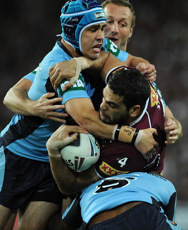 July 6th 2011: Greg Inglis of the Maroons is tackled during game 3 of the 2011 State of Origin series at Suncorp Stadium in Brisbane, QLD, Australia on July 6, 2011. Photo by Matt Roberts / mattrimages.com.au / QRL