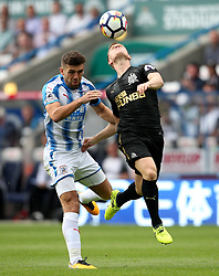 Newcastle United's Matt Ritchie challenges Huddersfield Town's Tommy Smith - Mandatory by-line: Matt McNulty/JMP - 20/08/2017 - FOOTBALL - John Smith's Stadium - Huddesfield, England - Huddersfield Town v Newcastle United - Premier League