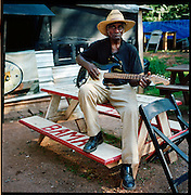 "BESSEMER, AL – OCTOBER 15, 2011: Blues legend Henry ""Gip"" Gipson, 90, rehearses a song in preparation for a show in his backyard juke joint. <br /> <br /> After an altercation with the KKK in the 60's rendered his left hand badly broken, Gipson's method of guitar playing had to change. ""I had to crowd the strings,"" Gipson said, describing the method that he adopted. Today, Gipson operates Gip's Place, one of few true remaining juke joints in the country. ""Music don't care no color,"" Gipson said. ""And that's why I love blues, because blues deals with a story to tell you."""