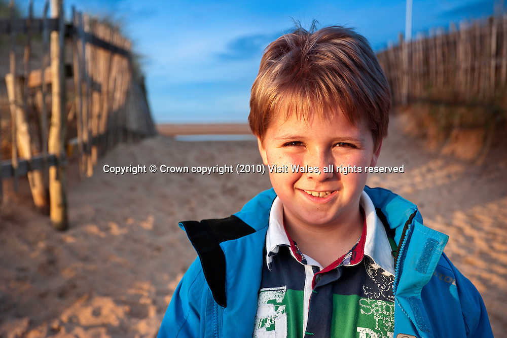Young boy out walking<br /> Wales Coast Path<br /> Point of Ayr<br /> Flintshire<br /> North<br /> Activities and Sports