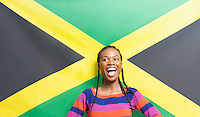Young excited woman against Jamaican flag